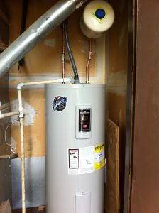 Water heater repair and installation. This is a photo of a new electric water heater that was installed in rio rancho for a property management company.